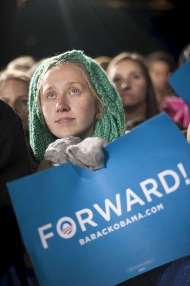 November 3, 2012 - Bristow, VA:  A young woman listens as President Barack Obama speaks at a rally in Bristow, VA a few days before the 2012 election. (Scout Tufankjian for Obama for America/Polaris)