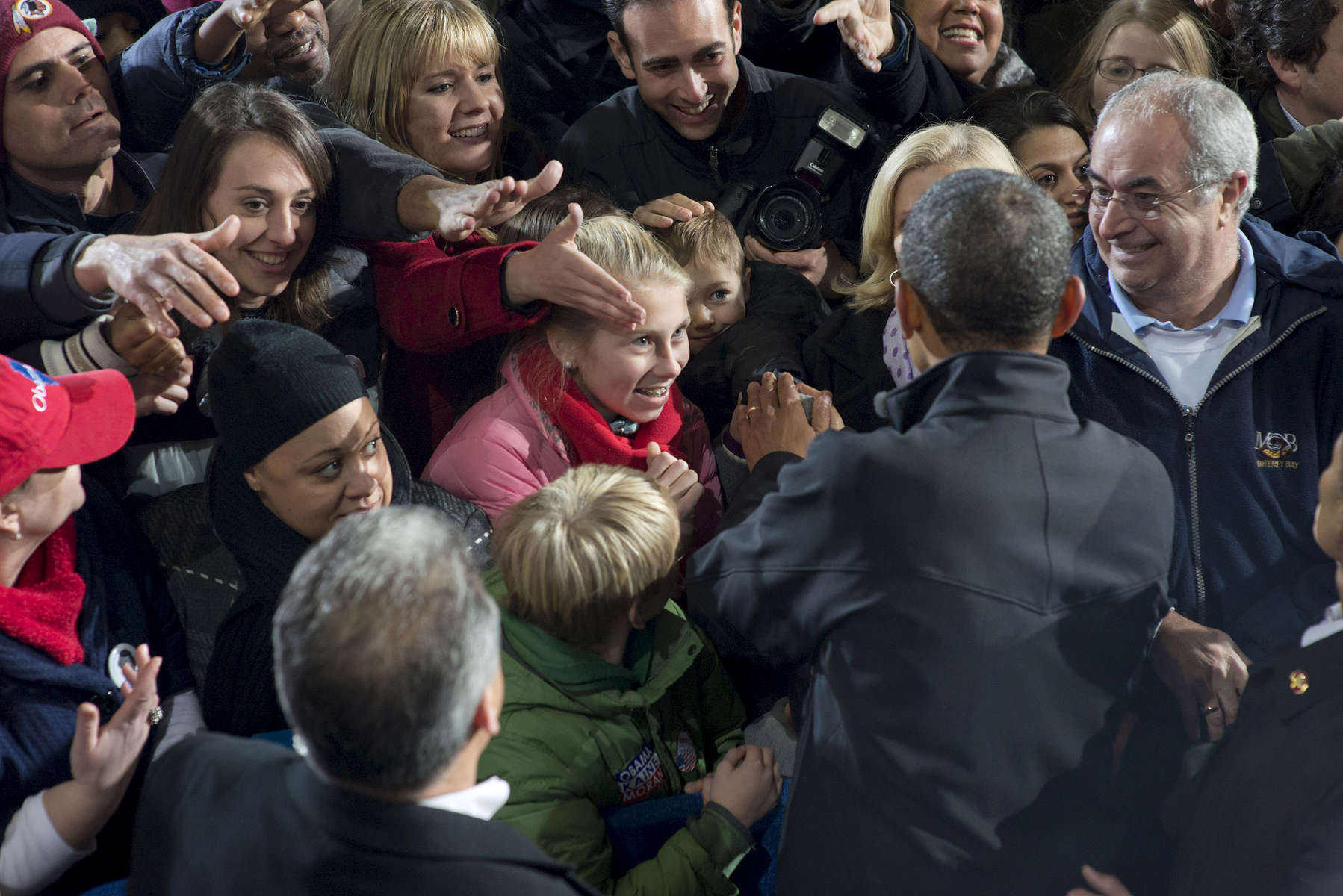 November 3, 2012 - Bristow, VA:  President Barack Obama hl's the hand of a little boy after a rally in Bristow, VA a few days before the 2012 election. (Scout Tufankjian for Obama for America/Polaris)