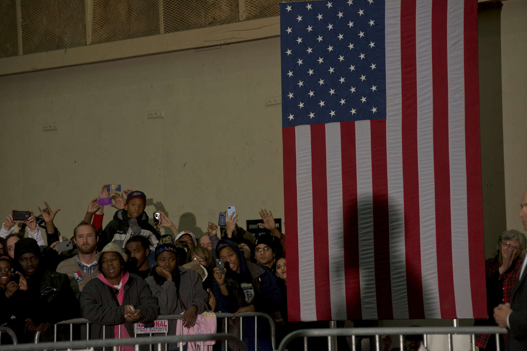 November 4, 2012 - Cincinnati, OH: President Barack Obama's shadow is cast upon an American flag as he speaks to an overflow crowd before a rally in Cincinnati.  (Scout Tufankjian for Obama for America/Polaris)