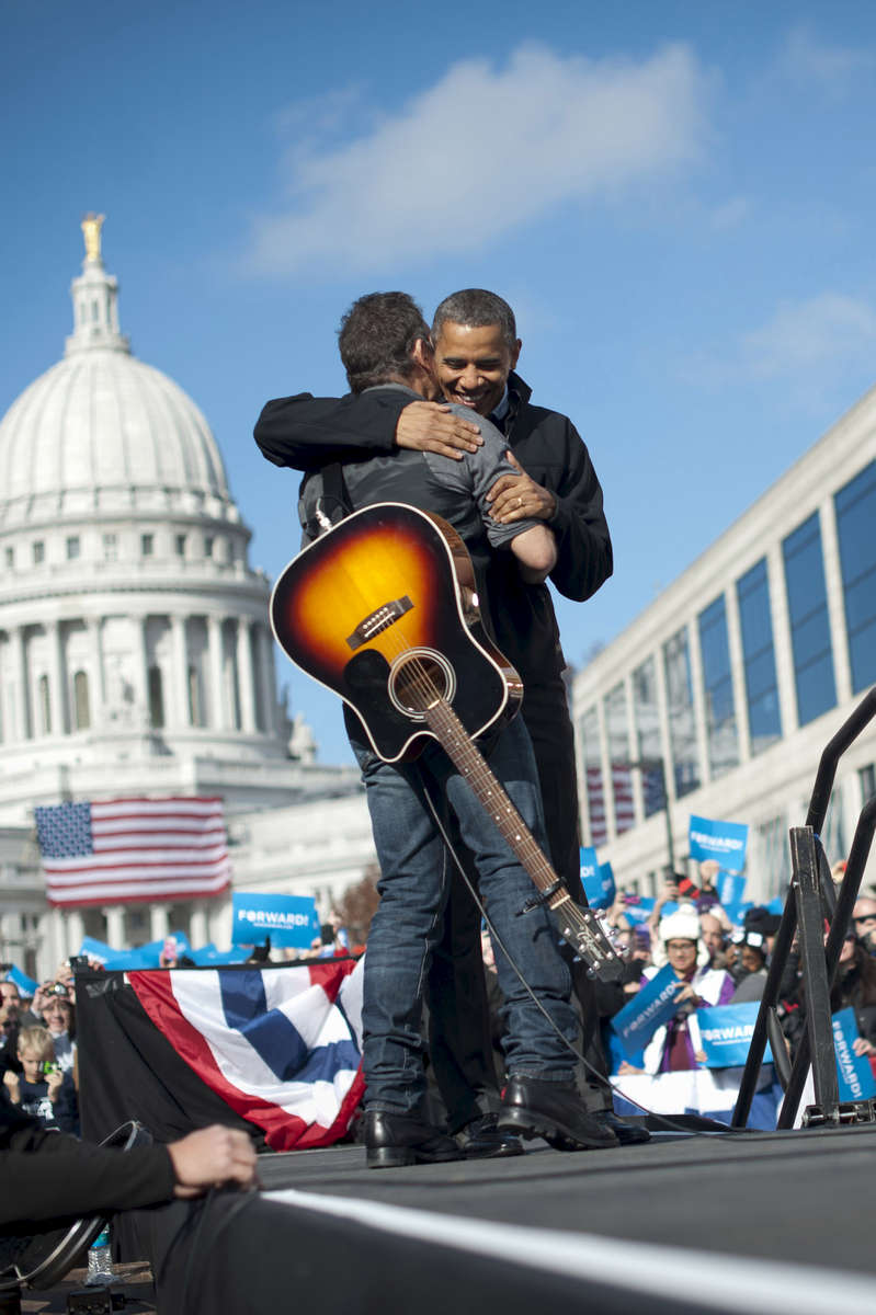 November 5, 2012 - Madison, WI: President Barack Obama embraces Bruce Springsteen after the rocker introduced him at a rally in Madison, WI the day before the 2012 election.  (Scout Tufankjian for Obama for America/Polaris)