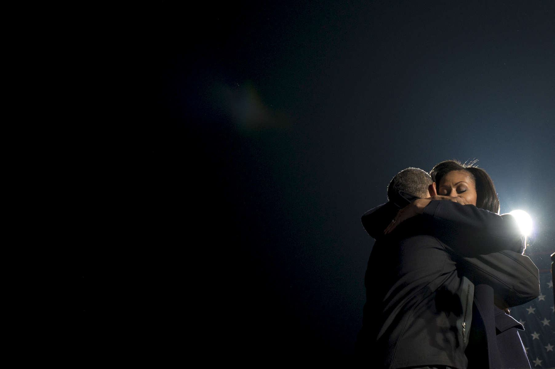 November 5, 2012 - Des Moines, IA:  President Barack Obama and First Lady Michelle Obama embrace onstage during his last ever campaign event the night before the 2012 election. (Scout Tufankjian for Obama for America/Polaris)