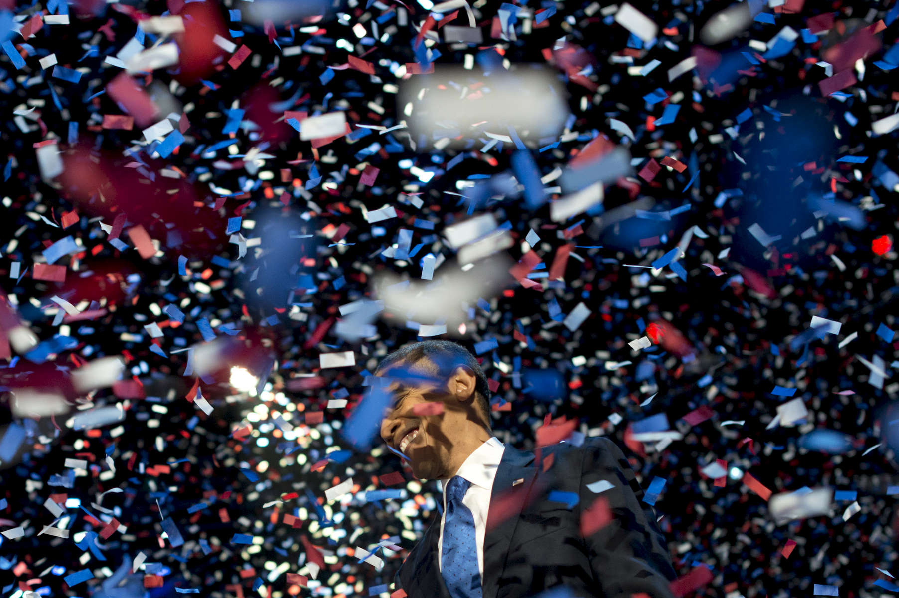 November 7, 2012: Chicago, IL:  President Barack Obama smiles as confetti flies in the air at a victory rally at Chicago's McCormick Place on Election Night. (Scout Tufankjian for Obama for America/Polaris)
