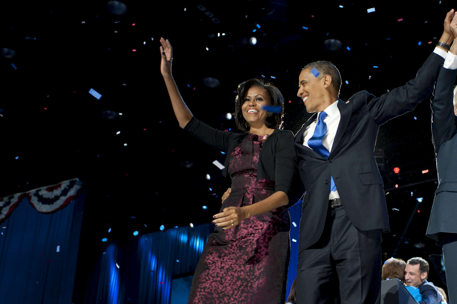 November 7, 2012: Chicago, IL:  President Barack Obama and First Lady Michelle Obama wave to the crowd at a victory rally at Chicago's McCormick Place on Election Night. (Scout Tufankjian for Obama for America/Polaris)