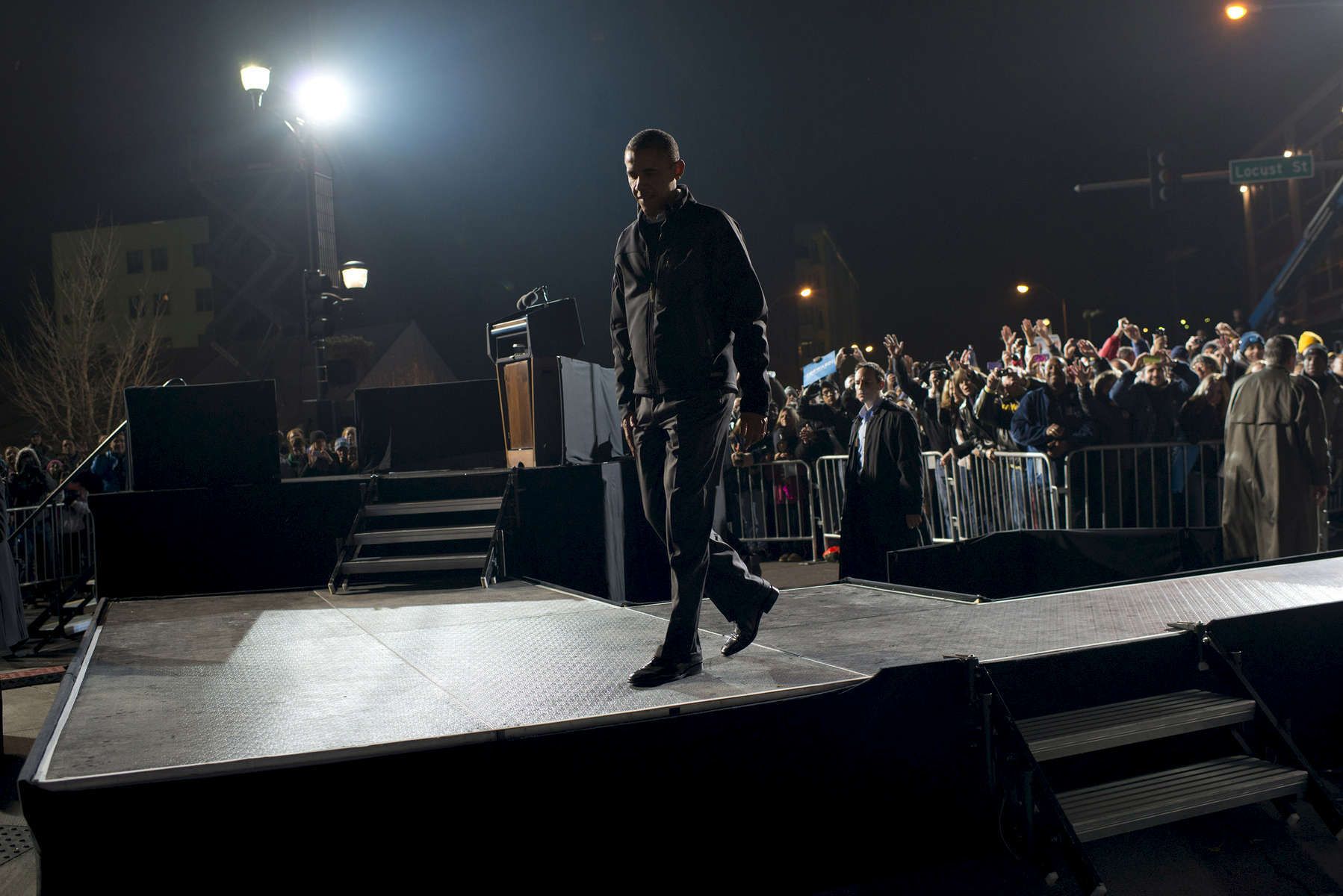 November 5, 2012 - Des Moines, IA:  President Barack Obama walks offstage after his last ever campaign event the night before the 2012 election. (Scout Tufankjian for Obama for America/Polaris)