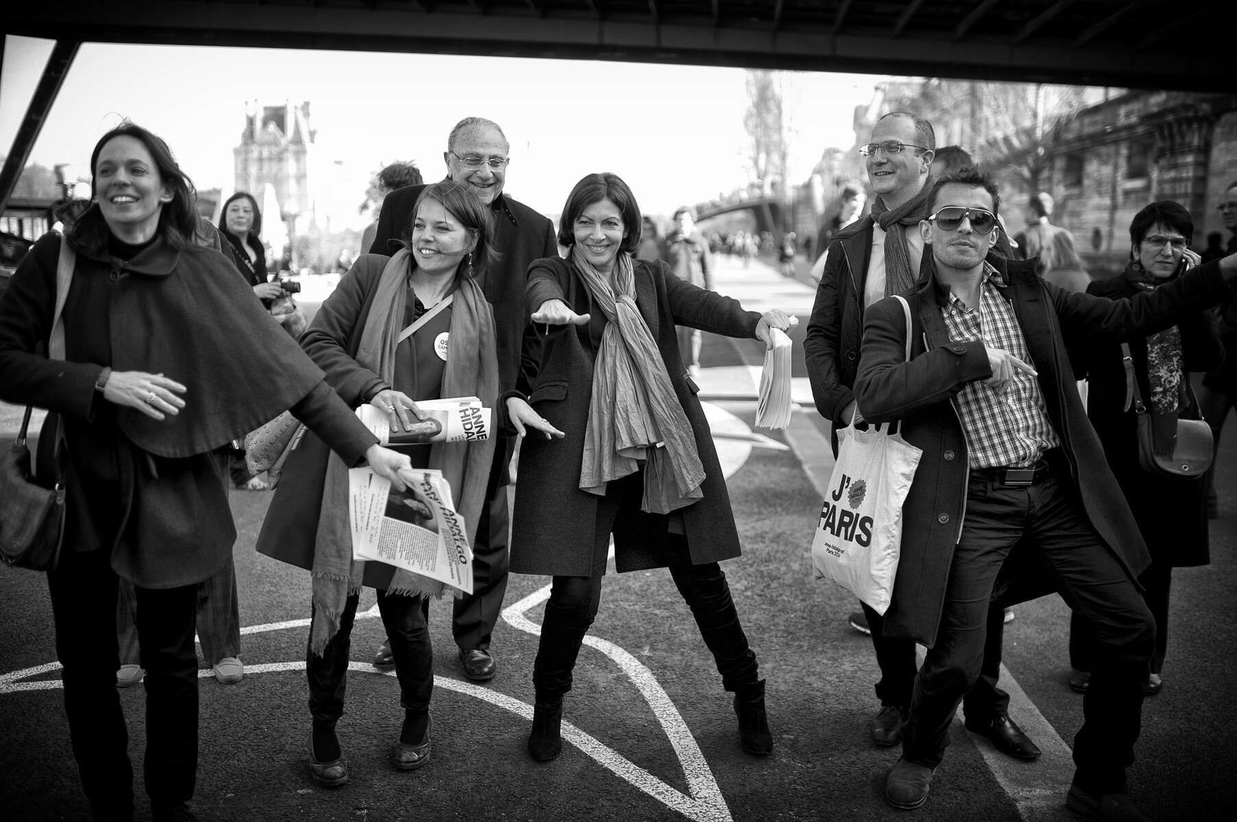 March 08, 2014.  PARIS, FRANCE-  Mayoral candidate Anne Hidalgo does a few dance steps with her staff near a section of the Seine that is holding a massive public Zumba class on International Women's Day.  For the first time in France's history, Paris will have a woman as a mayor - either Socialist Anne Hidalgo or Center-Right Nathalie Kosciusko-Morizet.  Photo by Scout Tufankjian