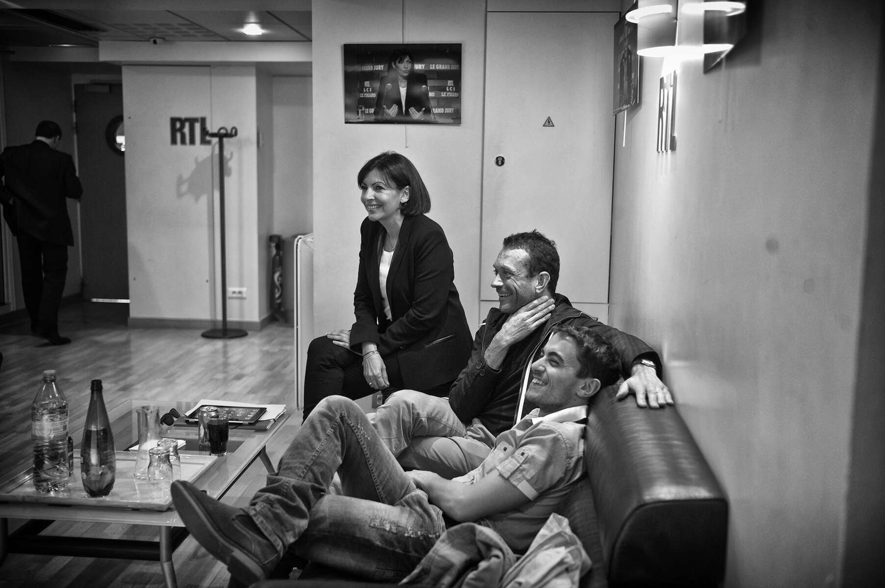March 10, 2014.  PARIS, FRANCE- Mayoral candidate Anne Hidalgo watches her opponant, Nathalie Kosciusko-Morizet appear on RTL's Le Grand Jury, as she and her team wait backstage for her turn to be interviewed.  For the first time in France's history, Paris will have a woman as a mayor - either Socialist Anne Hidalgo or Center-Right Nathalie Kosciusko-Morizet.  Photo by Scout Tufankjian