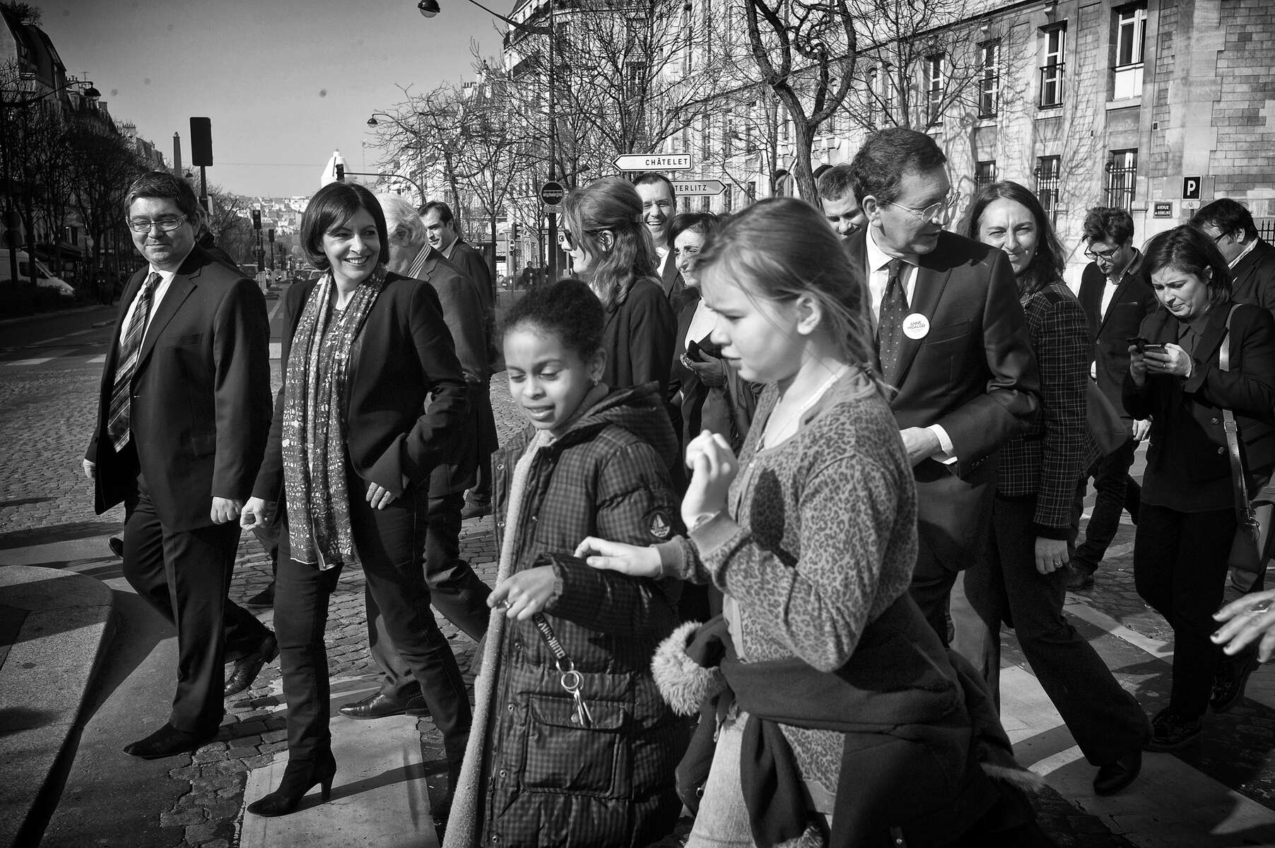 March 12, 2014.  PARIS, FRANCE- Mayoral candidate Anne Hidalgo walks through a group of school kids as she attends a campaign event at Place d'Italie with Ignazio Marino, the Mayor of Rome.  For the first time in France's history, Paris will have a woman as a mayor - either Socialist Anne Hidalgo or Center-Right Nathalie Kosciusko-Morizet.  Photo by Scout Tufankjian