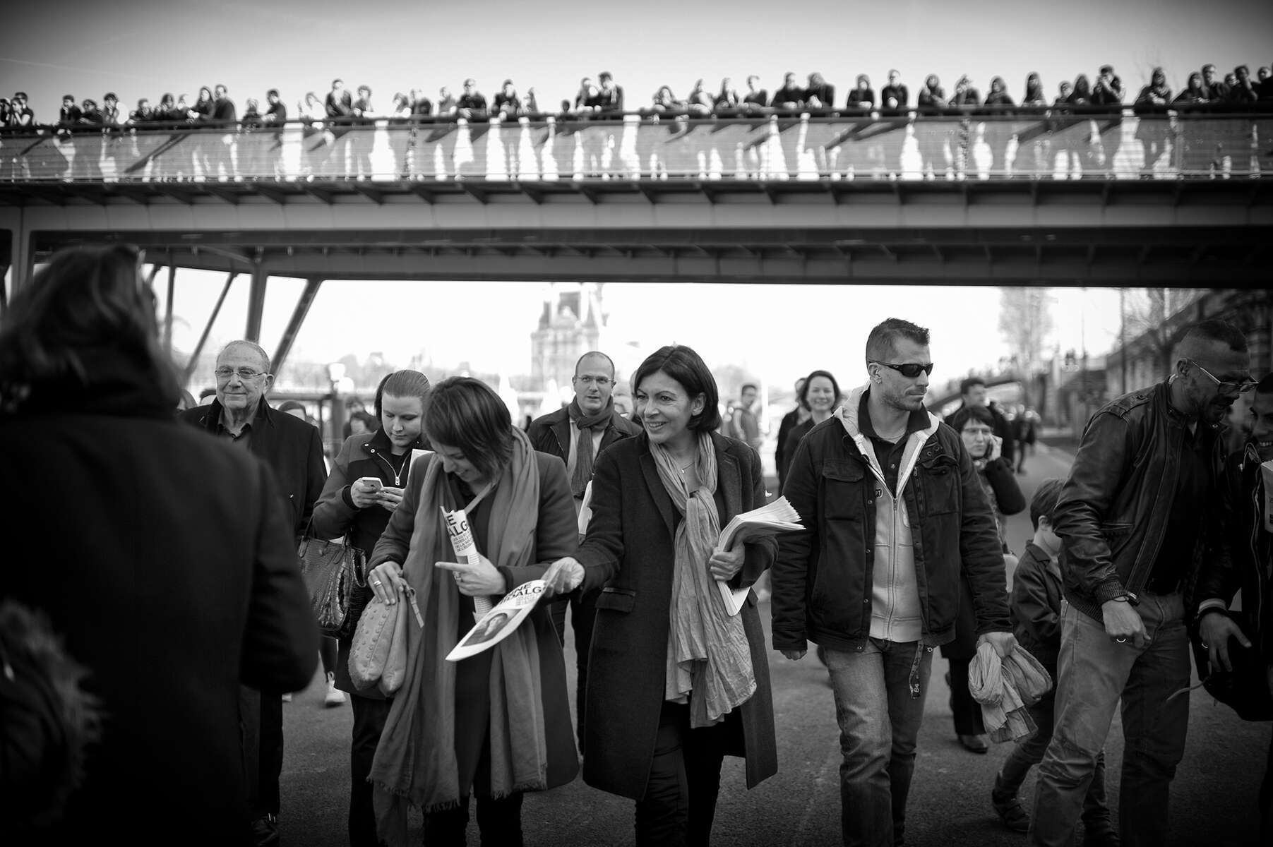 March 08, 2014.  PARIS, FRANCE-  Mayoral candidate Anne Hidalgo greets supporters along the Seine on International Women's Day.  For the first time in France's history, Paris will have a woman as a mayor - either Socialist Anne Hidalgo or Center-Right Nathalie Kosciusko-Morizet.  Photo by Scout Tufankjian