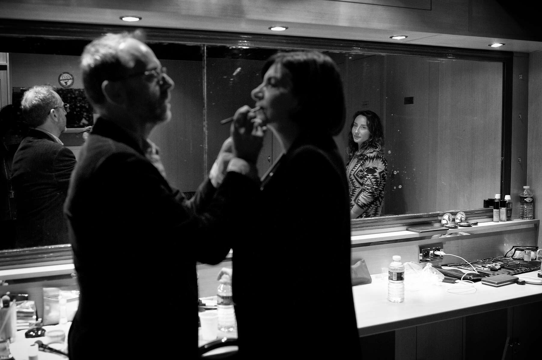 March 13, 2014.  PARIS, FRANCE- A makeup artist watches as a colleague touches up the lipstick of mayoral candidate Anne Hidalgo before her big rally at Paris' historic Cirque d'Hiver.  For the first time in France's history, Paris will have a woman as a mayor - either Socialist Anne Hidalgo or Center-Right Nathalie Kosciusko-Morizet.  Photo by Scout Tufankjian