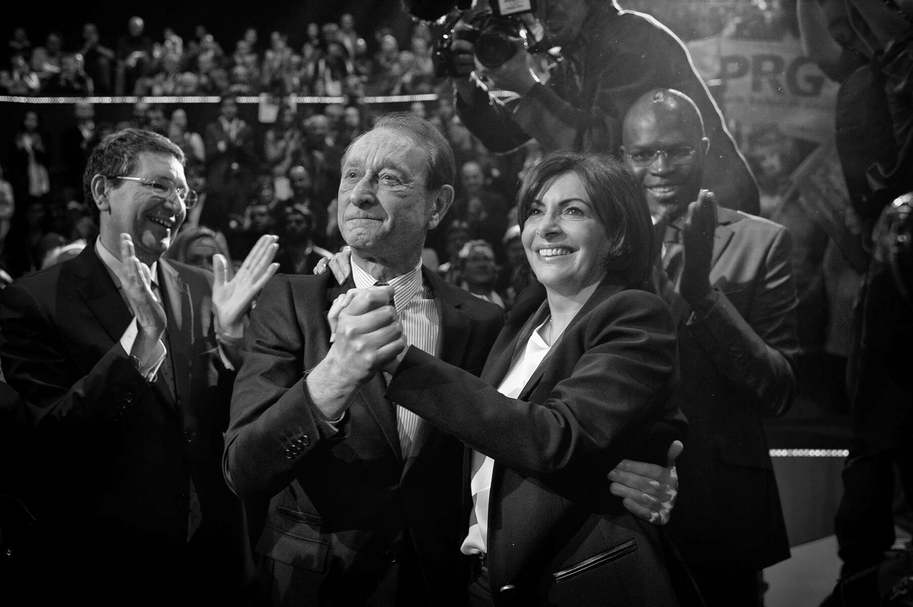 March 13, 2014.  PARIS, FRANCE- Mayoral candidate Anne Hidalgo embraces current Paris Mayor Bertrand Delanoë at her big rally at Paris' historic Cirque d'Hiver.  For the first time in France's history, Paris will have a woman as a mayor - either Socialist Anne Hidalgo or Center-Right Nathalie Kosciusko-Morizet.  Photo by Scout Tufankjian