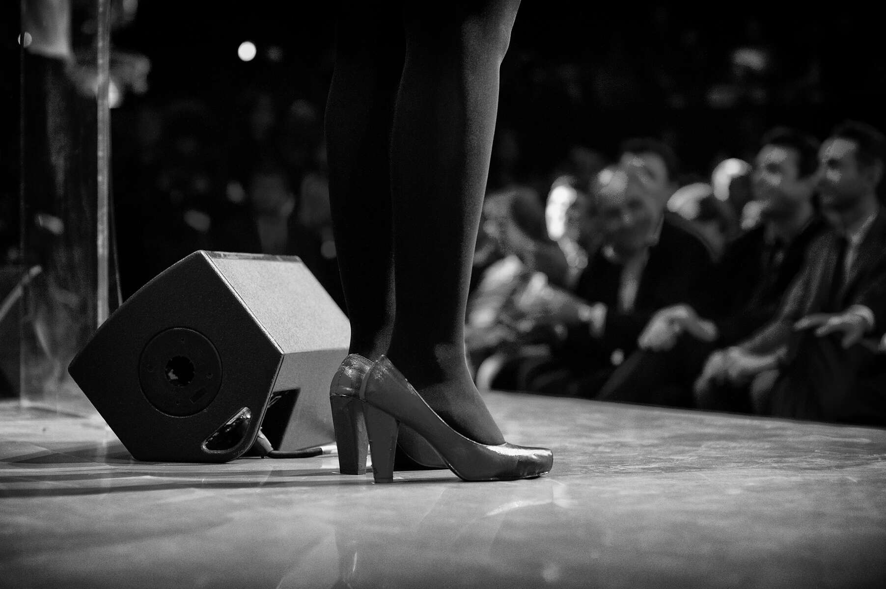 March 13, 2014.  PARIS, FRANCE- The MC at mayoral candidate Anne Hidalgo's big rally at Paris' historic Cirque d'Hiver wears fabulous shoes.  For the first time in France's history, Paris will have a woman as a mayor - either Socialist Anne Hidalgo or Center-Right Nathalie Kosciusko-Morizet.  Photo by Scout Tufankjian