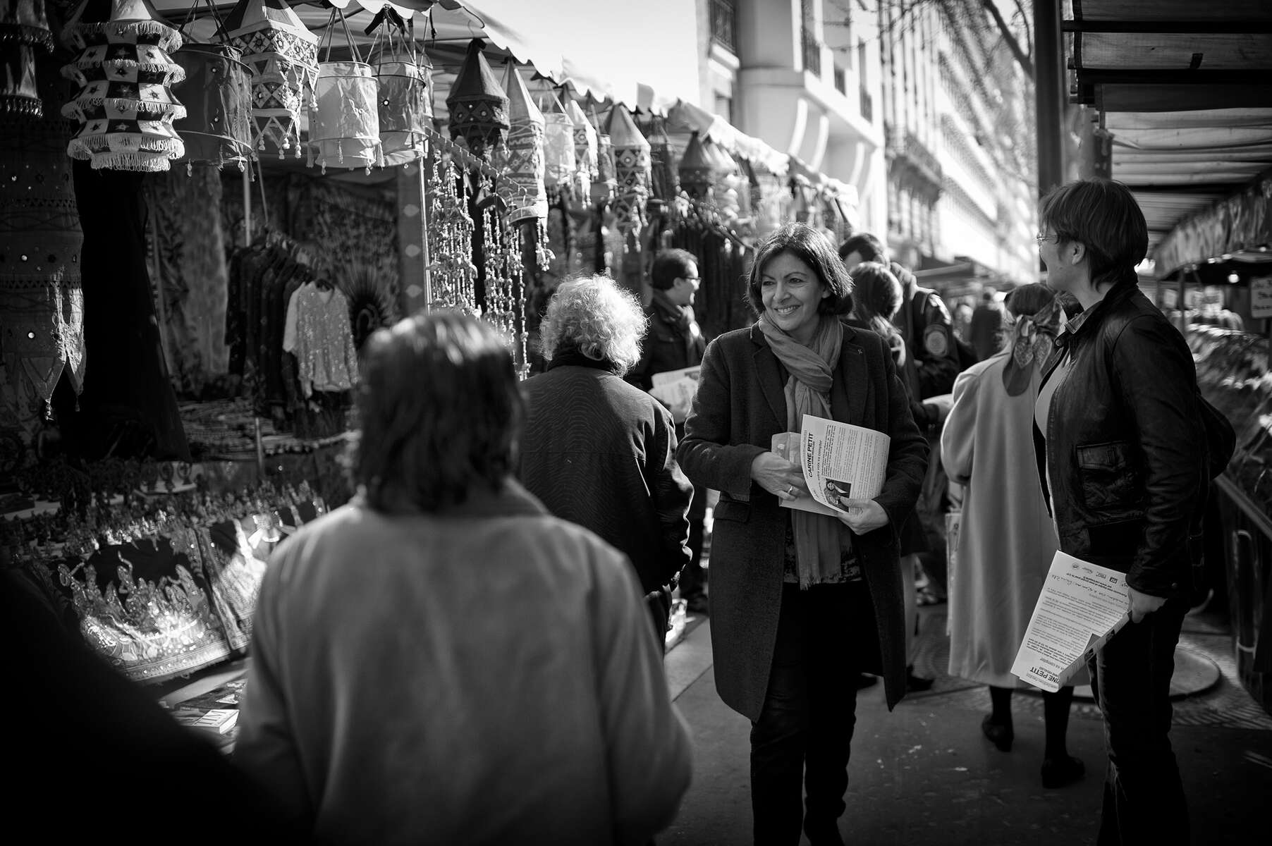 March 16, 2014.  PARIS, FRANCE- Anne Hidalgo tchats with voters in the Marche Brune in Paris' 14th arrondissement.   For the first time in France's history, Paris will have a woman as a mayor - either Socialist Anne Hidalgo or Center-Right Nathalie Kosciusko-Morizet.  Photo by Scout Tufankjian