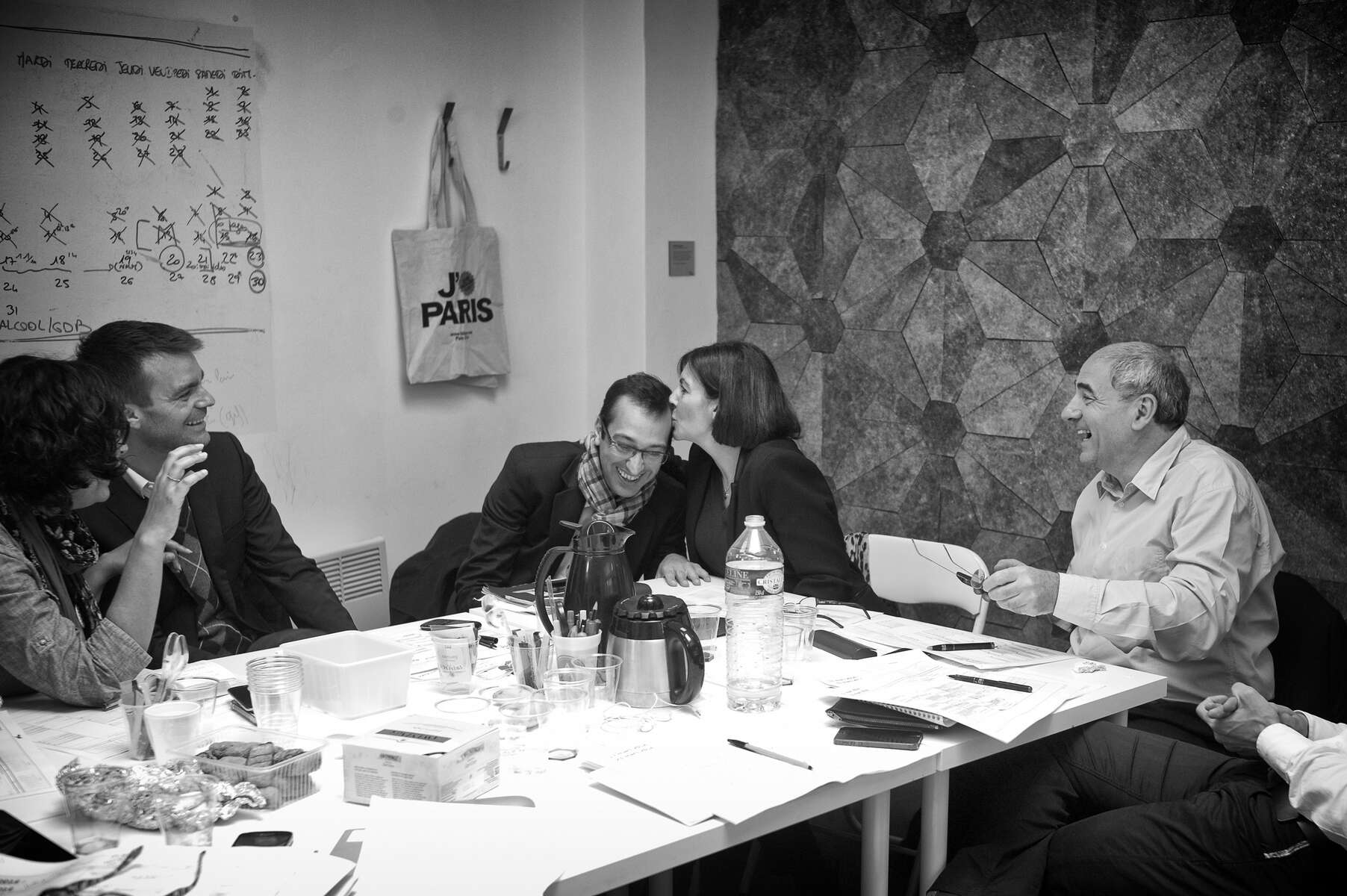 March 17, 2014.  PARIS, FRANCE- Mayoral candidate Anne Hidalgo takes notes on her calendar during a meeting with senior staff in her campaign's headquarters in Paris' Bastille neighborhood, including spokespeople Myriam El Khomri and Bruno Julliard, campaign co-directors Remi Feraud and Jean-Louis Missika (around Hidalgo), press liaison Hervé Marro, campaign coordinator Alexandra Cordebard, communications expert Philippe Grangeon, director of staff Jean-Marie Vernat, chief of staff Laure Moline, and advisor Elisa Yavchitz.   For the first time in France's history, Paris will have a woman as a mayor - either Socialist Anne Hidalgo or Center-Right Nathalie Kosciusko-Morizet.  Photo by Scout Tufankjian