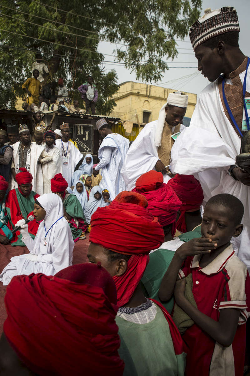 A female graduate of the Fatahul Mubin Islamic School sings part of the Koran during graduation in the Old City in Kano, Nigeria