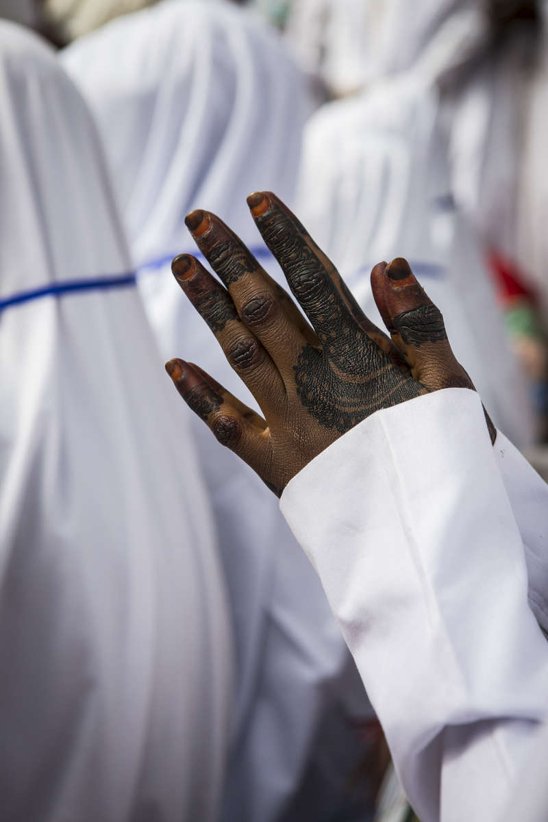 Graduate Halifa Ibrahim, prays during the Fatahul Mubin Islamic School graduation in the Old City in Kano, Nigeria