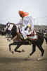 A member of the Emir of Kano, Muhammed Sanusi II, court races his horse outside the palace in Kano, Nigeria