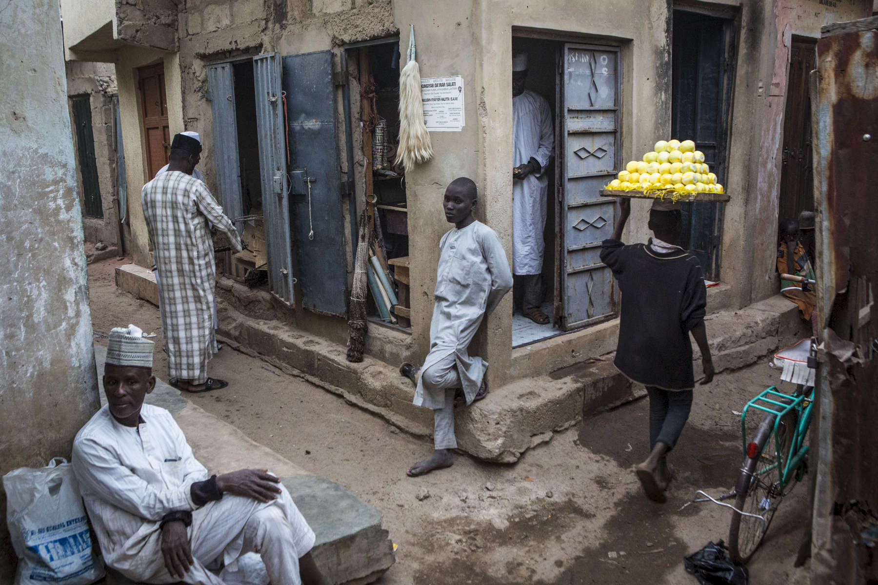 Kano, Nigeria- Men close their shops at the end of the day at the Kurmi Market in the Old City of  Kano, Nigeria on Tuesday, January 16, 2018.(Photo by Jane Hahn for the Washington Post)