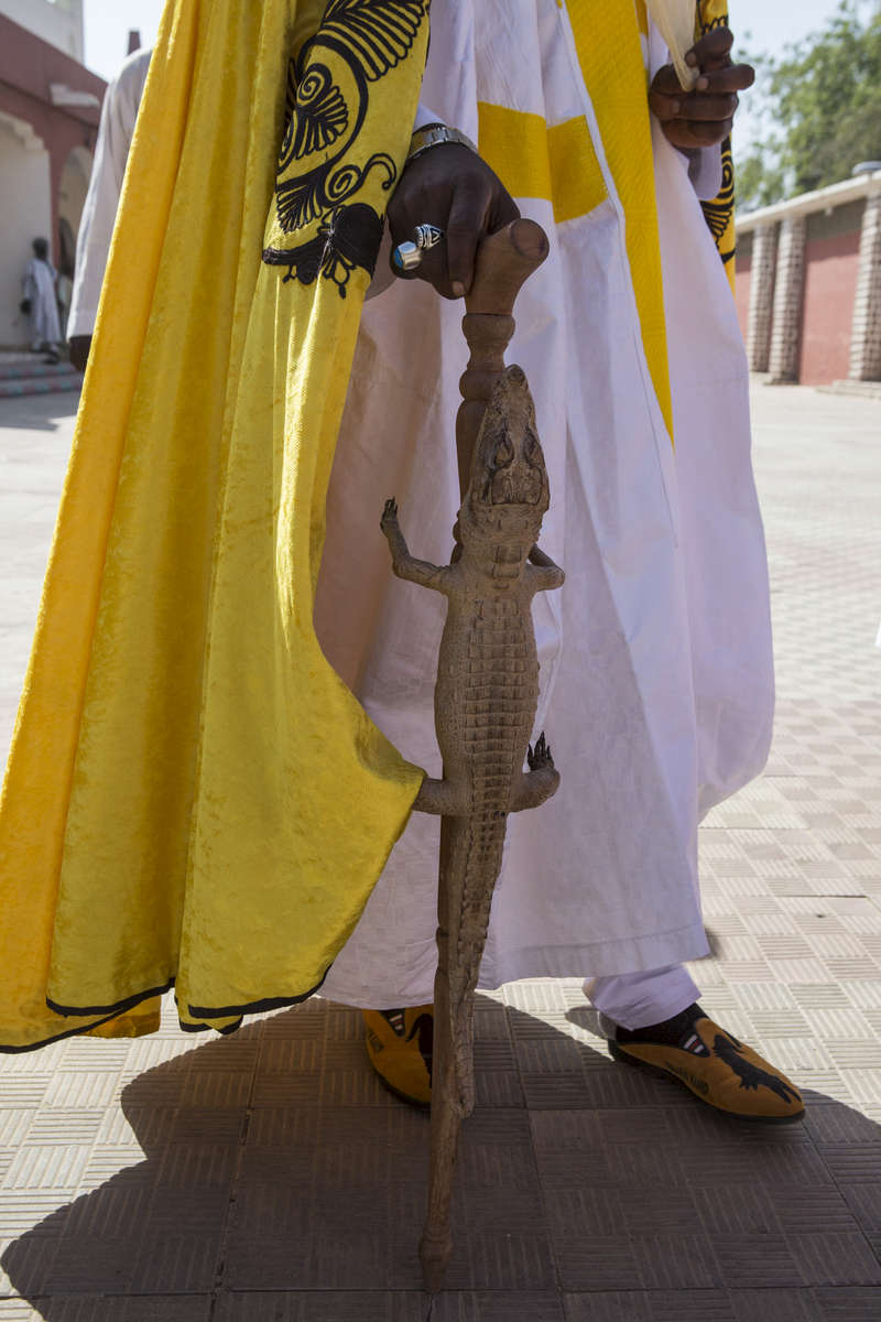 Mustafa Abba, the Emir of Kano's younger brother and personal secretary holds his cane that is fashioned with a crocodile at the palace in Kano, Nigeria