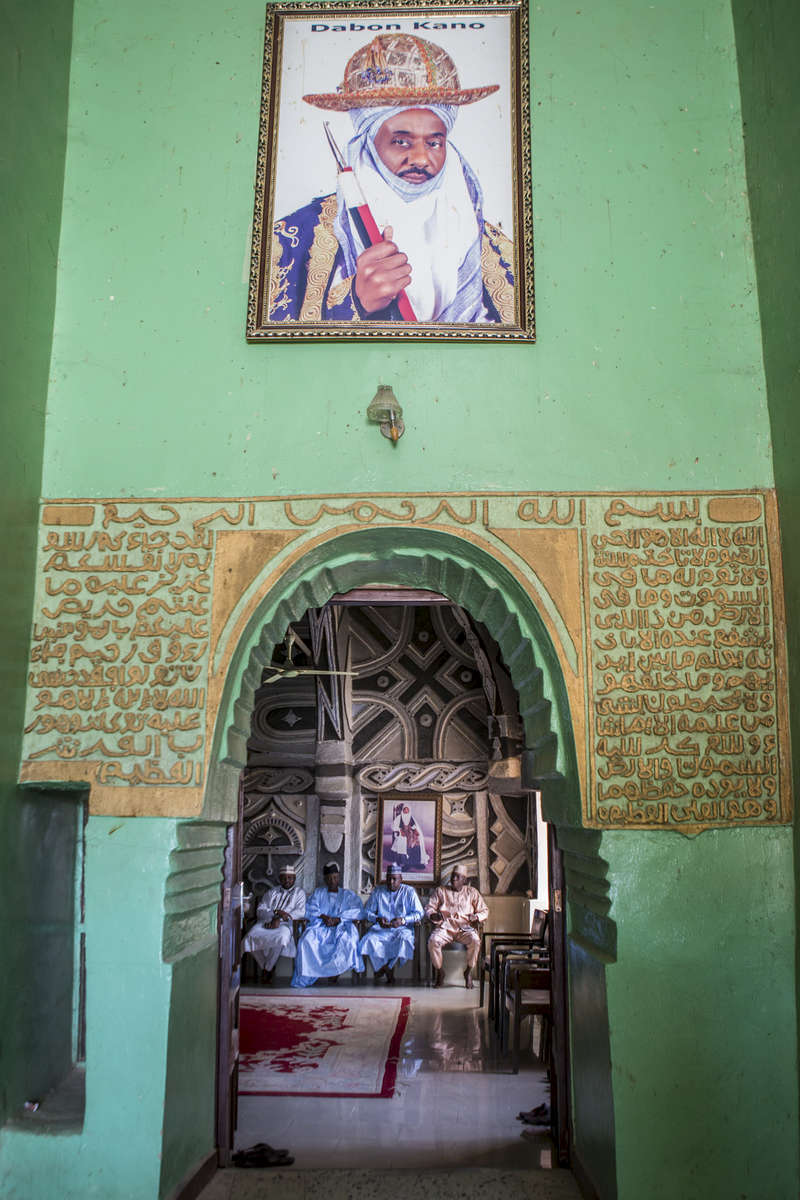 A portrait of the Emir of Kano, Muhammed Sanusi II, hangs above a doorway in the palace in Kano, Nigeria