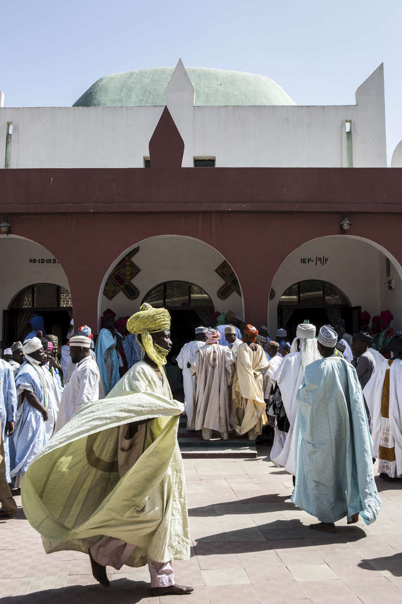Men wait outside the outer palace to pay respects or lodge complaints with the Emir of Kano, Muhammed Sanusi II in Kano, Nigeria