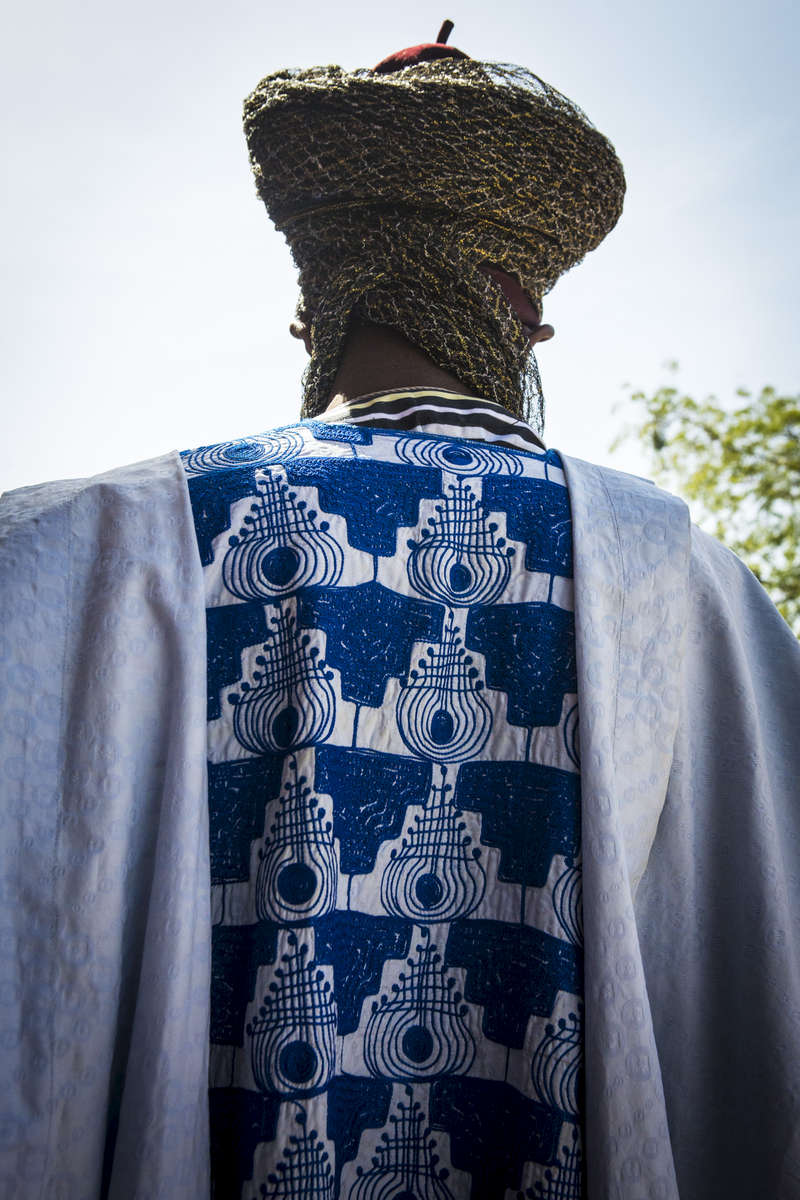 A trumpeter plays the horn as the Emir of Kano, Muhammed Sanusi II, prepares to leave the outer palace in Kano, Nigeria