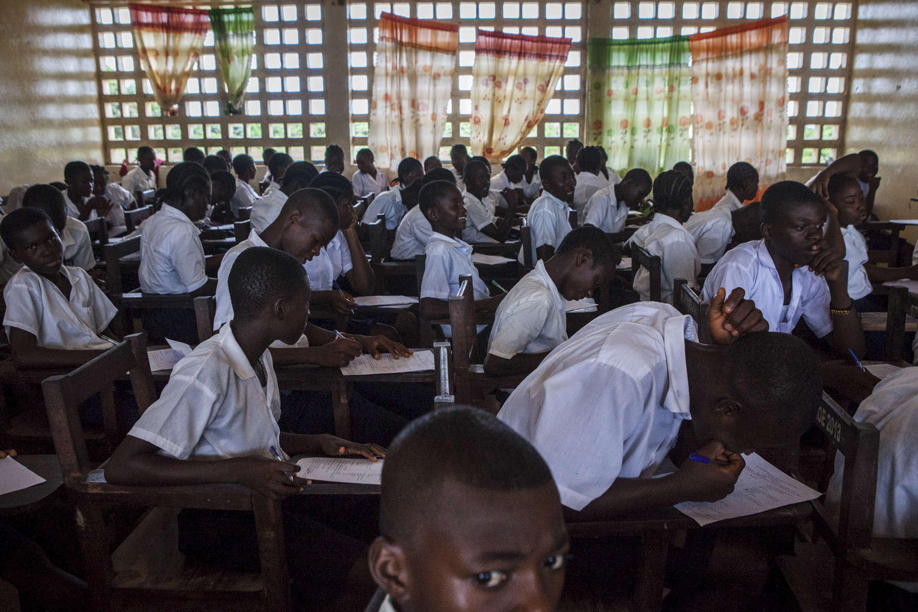 Students take exams at the R.S. Caufield Public School in Unification, Liberia