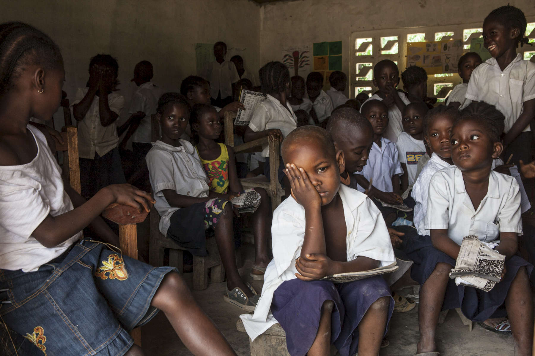 Students in an unsupervised classroom after the teacher went home sick at the Passama Public School in Gbarnga, Bong County, Liberia