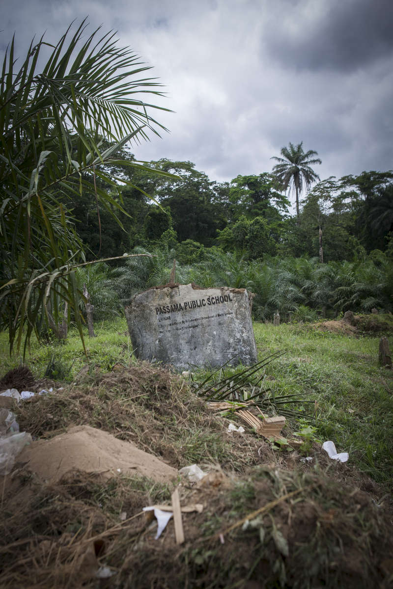 The remains of an old the latrine block outside the Passama Public School in Gbarnga, Bong County, Liberia