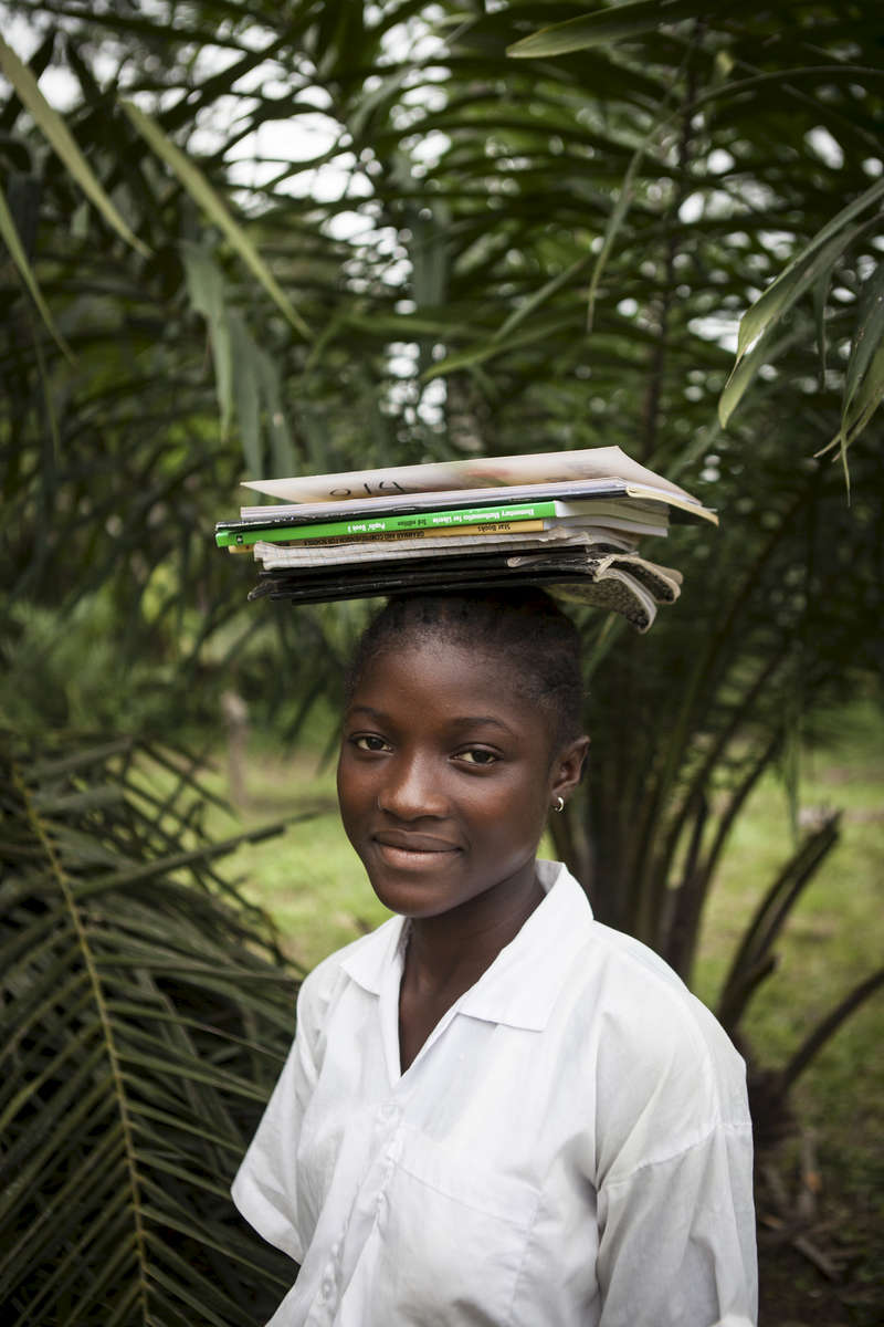 Rorena Sakie, 15, outside the Passama Public School in Gbarnga, Bong County, Liberia