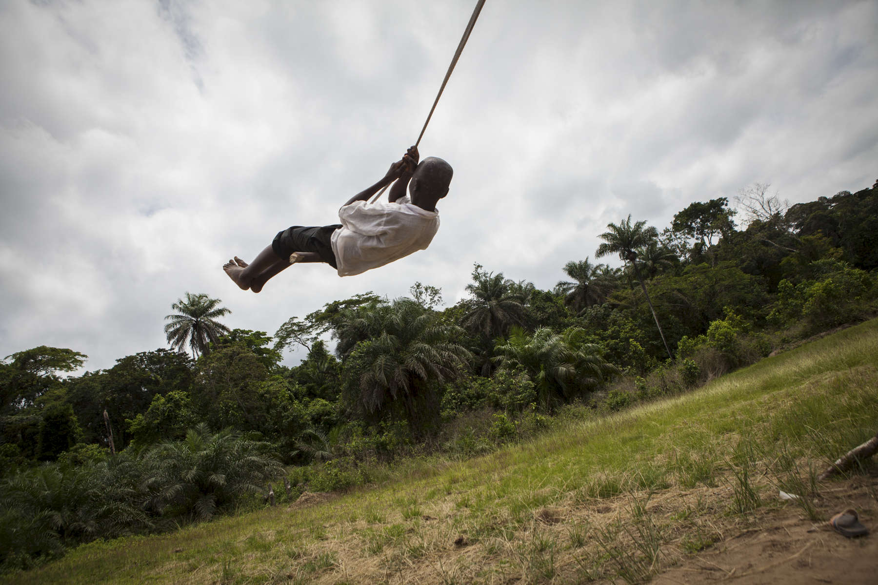 A student plays on the playground at the Passama Public School in Gbarnga, Bong County, Liberia