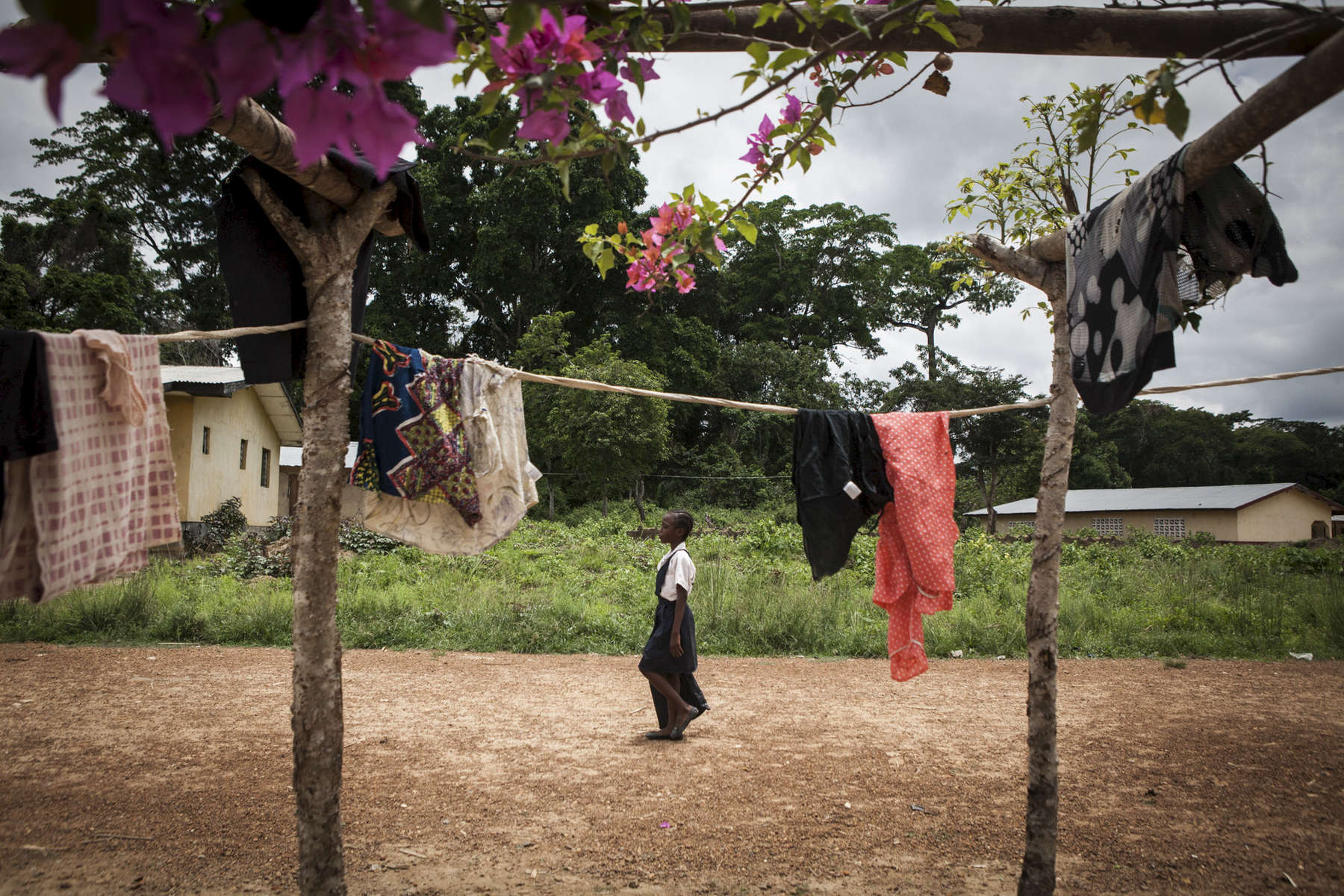 A student walks home after school from the Passama Public School in Gbarnga, Bong County, Liberia