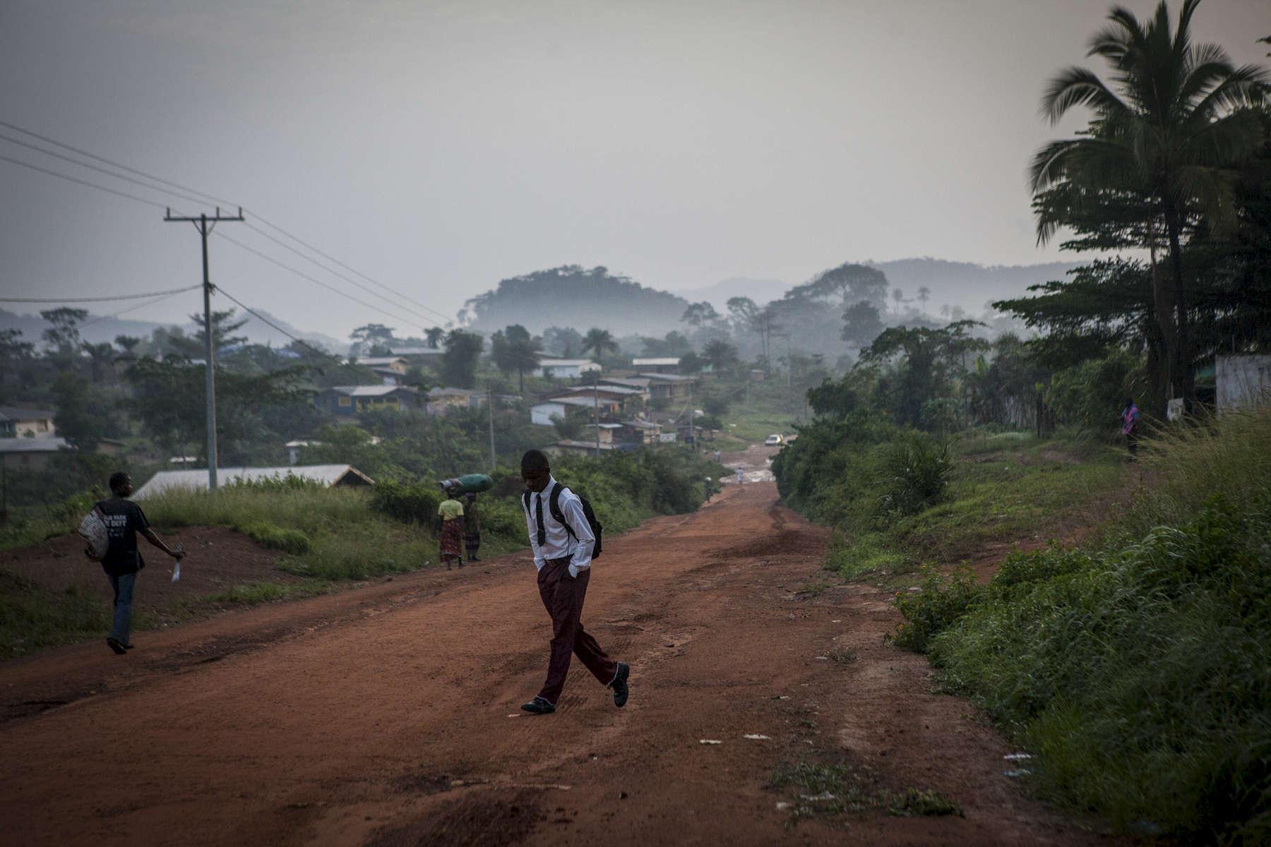 A boy walks to school in Nimba County, Liberia.