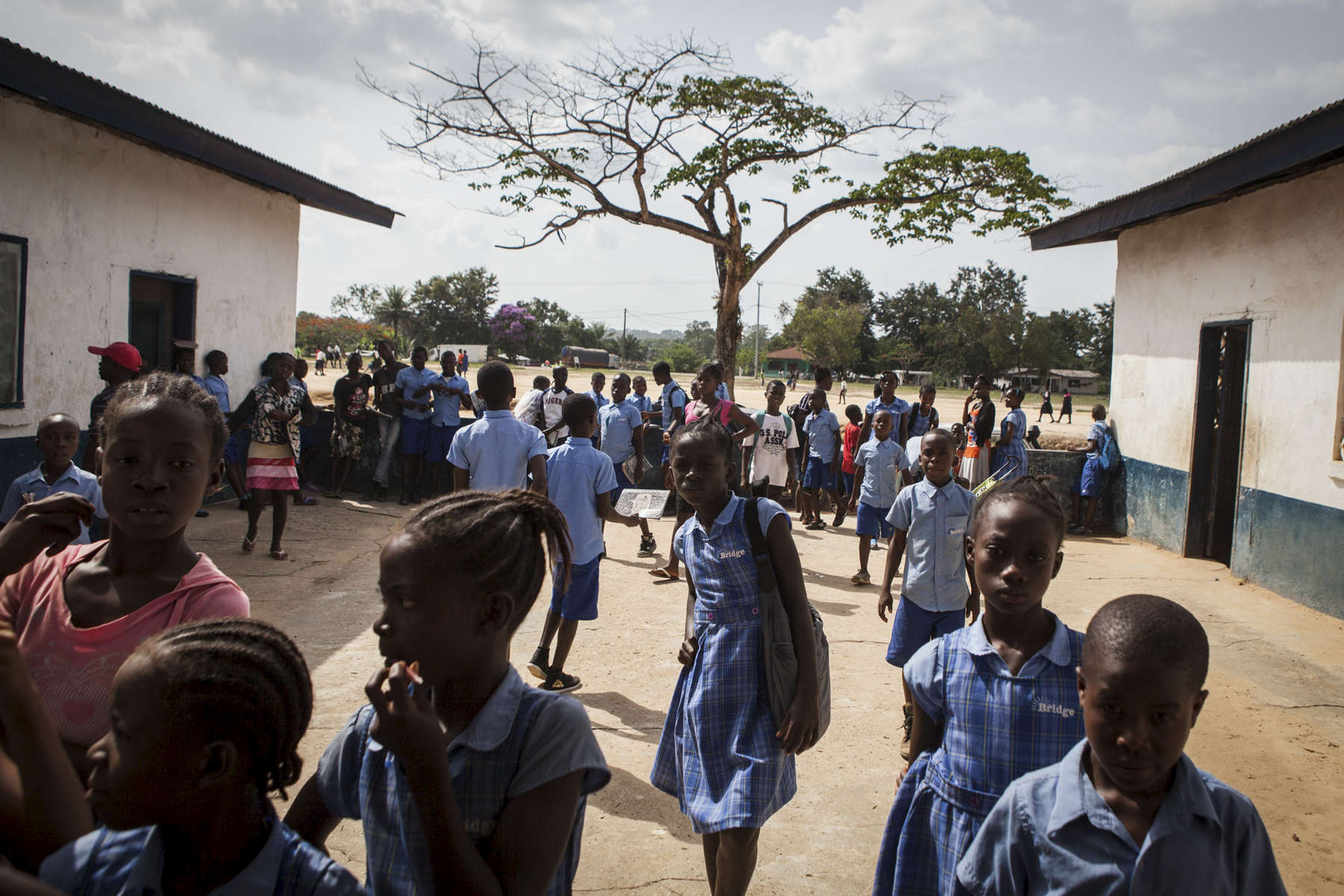 Students gather outside the Martha Tubman Elementary School after school in Nimba County, Liberia.