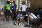A teacher advises her students in her K2 math class at the Cecilia A Dunbar Public School in Freeman Reserve, Liberia