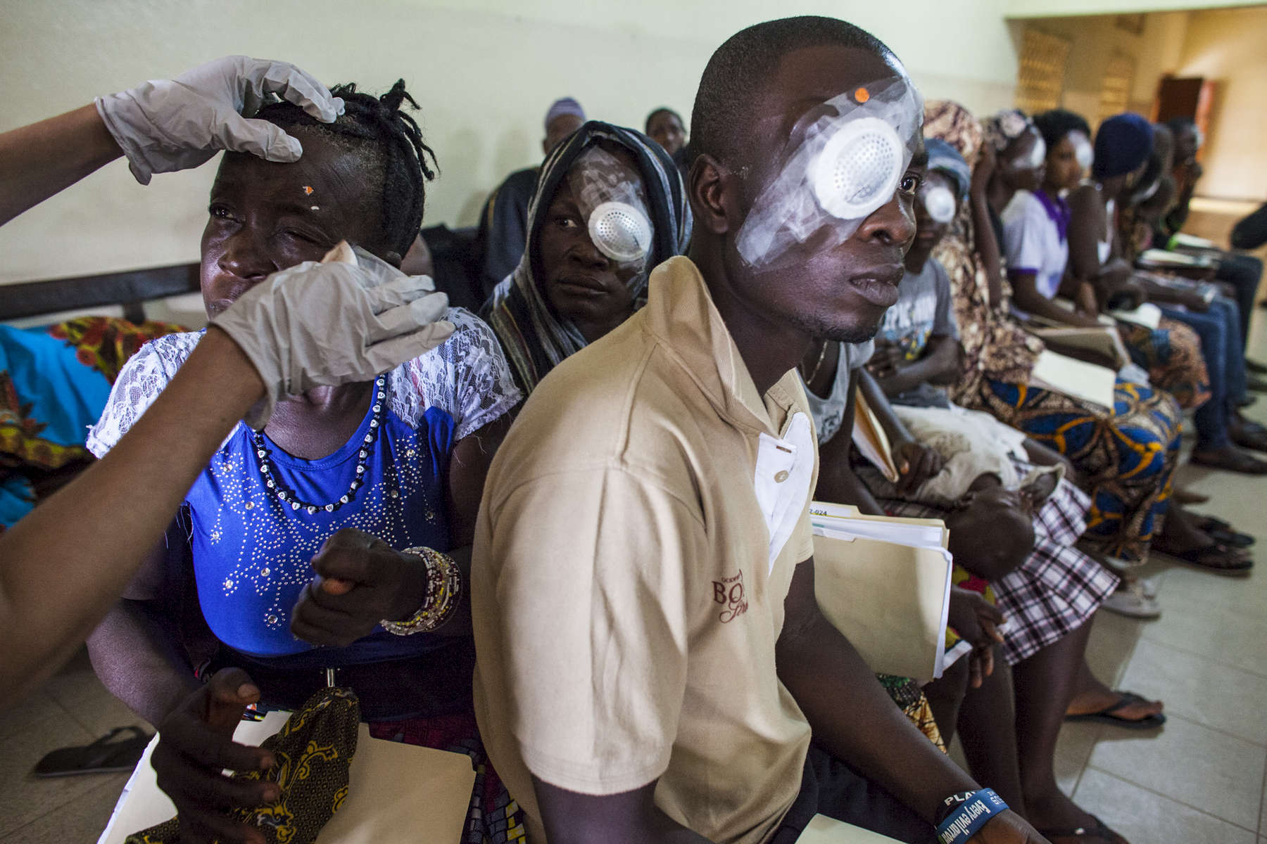 Ebola survivors have their bandages removed the day after their cataracts are removed at the Kissy United Methodist Church Eye Hospital in Freetown, Sierra Leone.