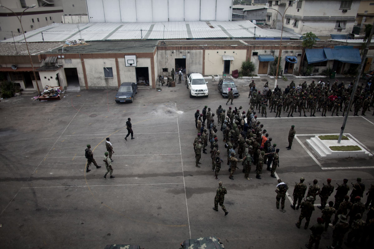 Soldiers for President Alassane Ouattara's Republican Forces gather at the former Republican Guard Headquarters in Treichville, a neighborhood of Abidjan, Ivory Coast in April 2011. After months of post election violence and thousands of deaths, Laurent Gbagbo finally ceded power to Alassane Ouattara with the backing of French and UN forces allied with the FRCI.