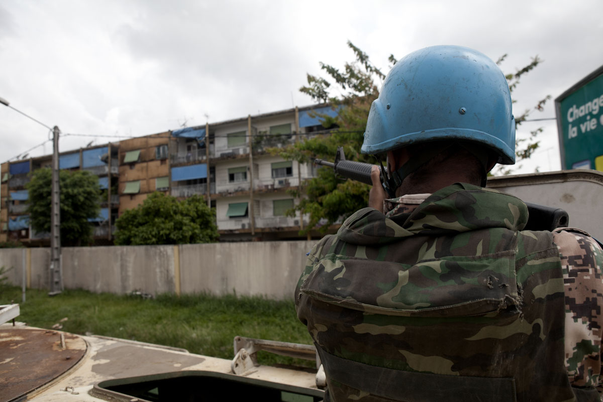 A Jordanian UN peacekeeper keeps watch for snipers while evacuating Lebanese expatriates in Abidjan, Ivory Coast in April 2011.