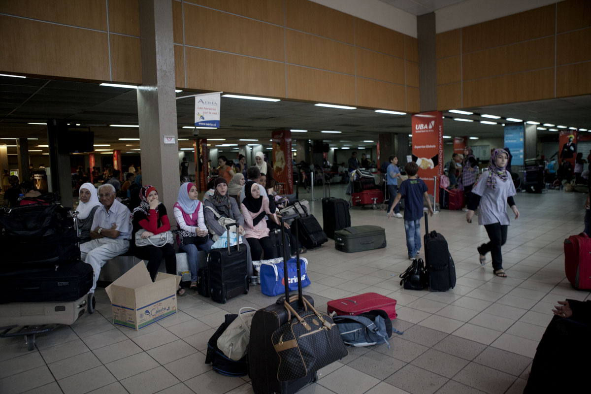 Foreigners wait at the airport to be evacuated in Abidjan, Ivory Coast in April 2011. After months of post election violence and thousands of deaths, Laurent Gbagbo finally ceded power to Alassane Ouattara with the backing of French and UN forces allied with the FRCI.
