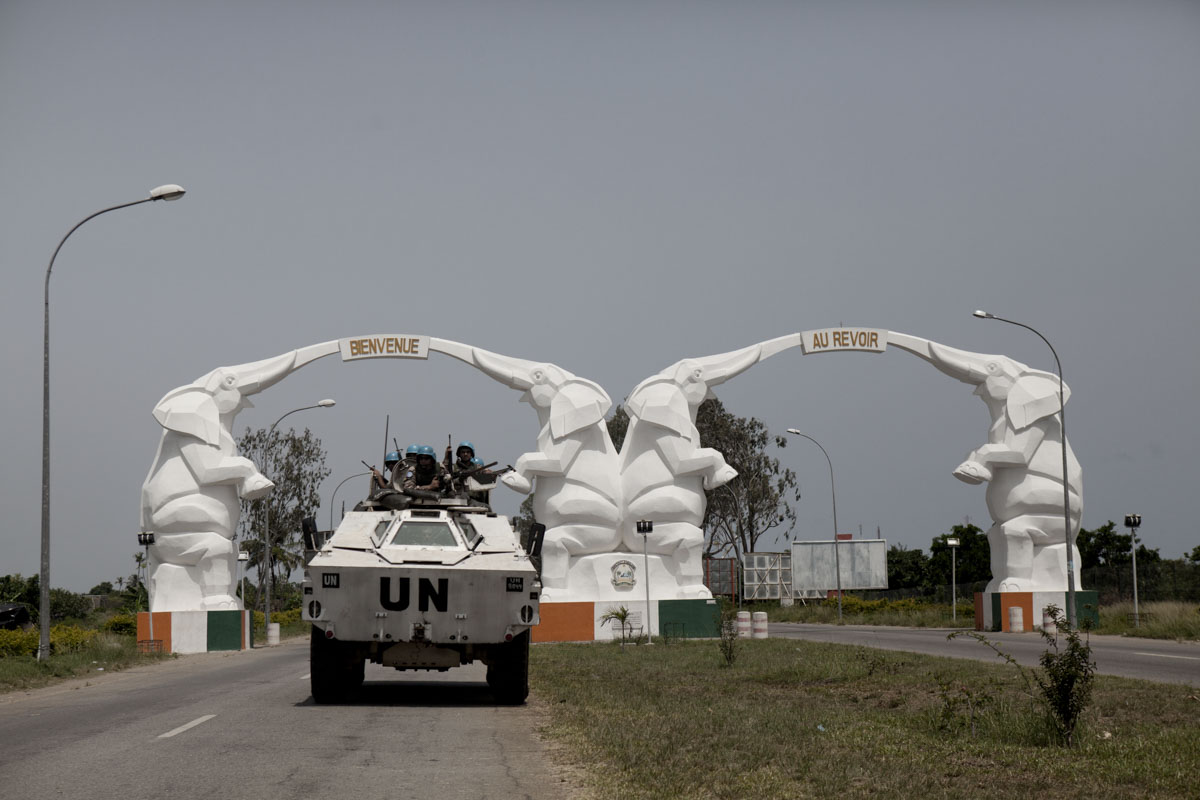 A Jordanian UN Peacekeeping APC passes through the entrance to the airport road in Abidjan, Ivory Coast in April 2011. After months of post election violence and thousands of deaths, Laurent Gbagbo and his wife Simone finally ceded power to Alassane Ouattara with the backing of French and UN forces allied with the FRCI.