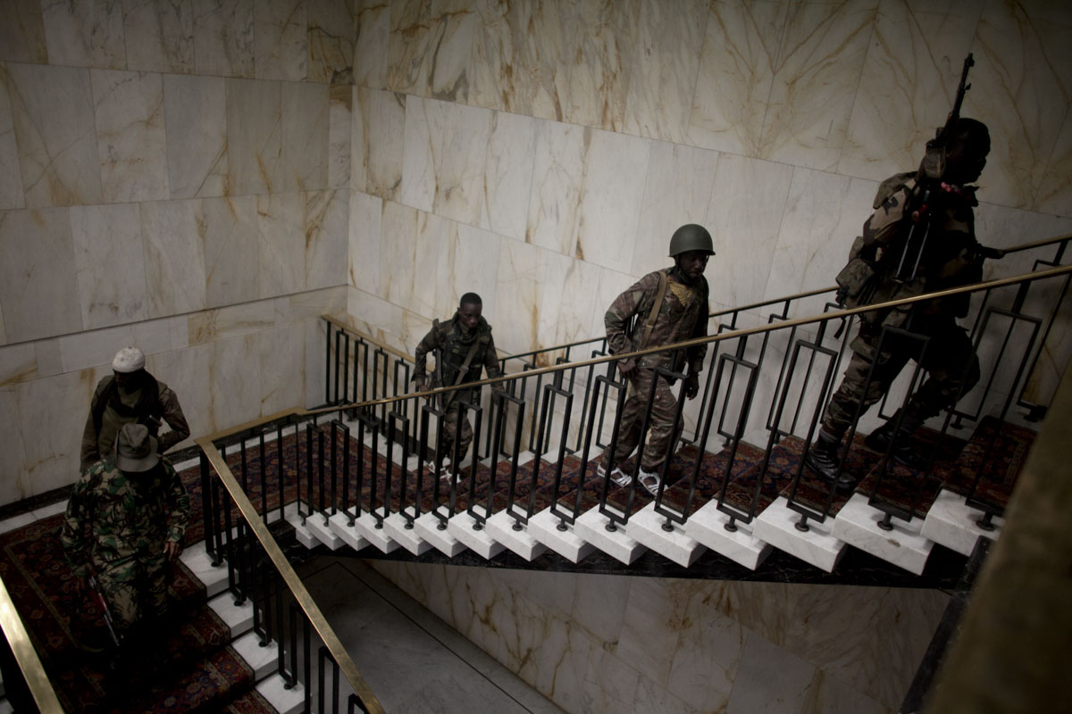 Republican Forces walk through the Presidential Palace in Abidjan, Ivory Coast in April 2011. Days after Laurent Gbagbo ceded power after heavy attacks by the French and Republican Forces, control has been established of the palace after looting took place.