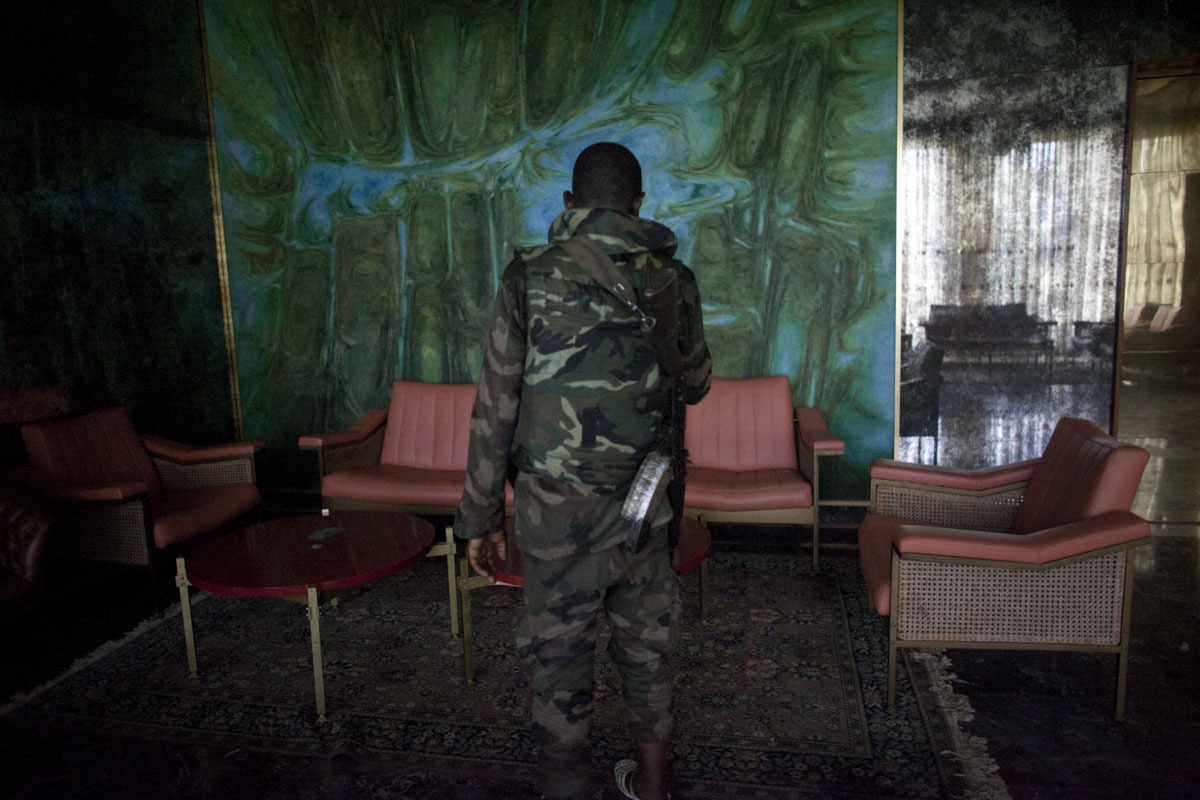A Republican Forces soldier walk through a the Presidential Palace in Abidjan, Ivory Coast in April 2011. Days after Laurent Gbagbo ceded power after heavy attacks by the French and Republican Forces, control has been established of the palace after looting took place.