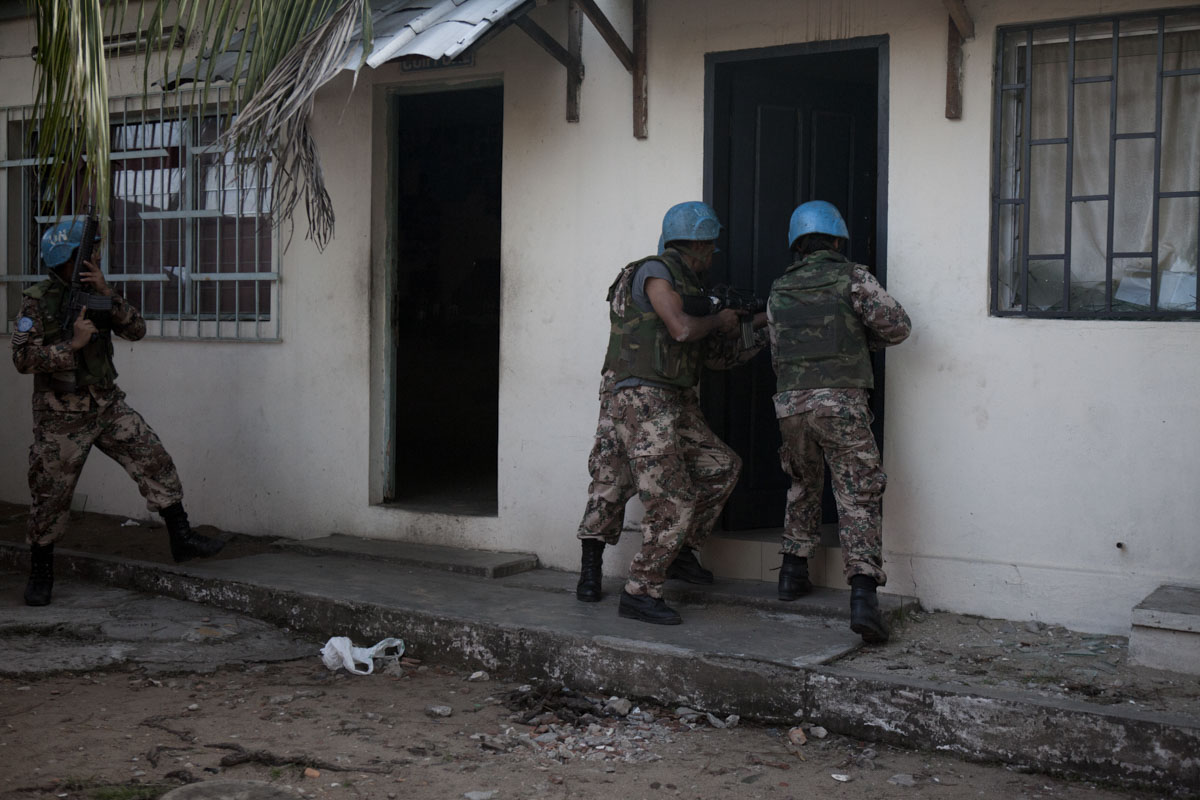 Jordanian UN Peacekeepers secure Laurent Gbagbo's Republican Guard Headquarters before removing weapons in Treichville a neighborhood in Abidjan, Ivory Coast in April 2011. After months of post election violence, Laurent Gbagbo finally ceded power to Alassane Ouattara with the aid of French and UN forces allied with the FRCI.