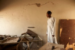 Abdul Majid, 28, a civilian staff member working at police headquarters looks over the remains of his office in the main building destroyed by a suicide bomber in Kano, Nigeria. 2012