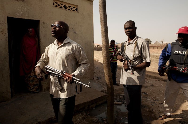 Nigerian security forces patrol the streets of the Tsamiyar Boka neighborhood the morning after an overnight raid which killed suspected Boko Haram member Uzairu Abba Abdullahi and his wife in their home in Kano, Nigeria. 2012