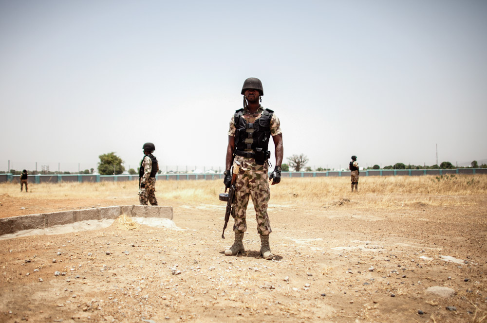 Members of the Nigerian military stand guard at an airfield in northeast Nigeria in March 2017.