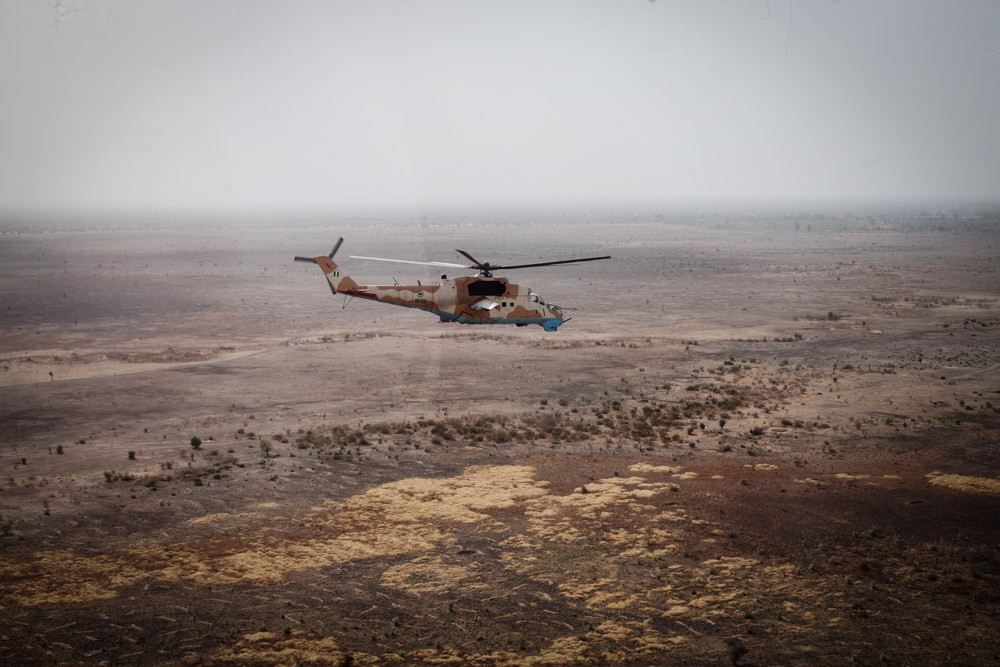 A Nigerian military helicopter flies over Borno State in April 2014.