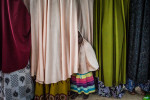 A young girl hides between chadors at a safe house for former wives of Boko Haram commanders in Maiduguri, Nigeria.