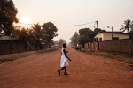 A young girl walks through the Castors neighborhood in Bangui, Central African Republic.