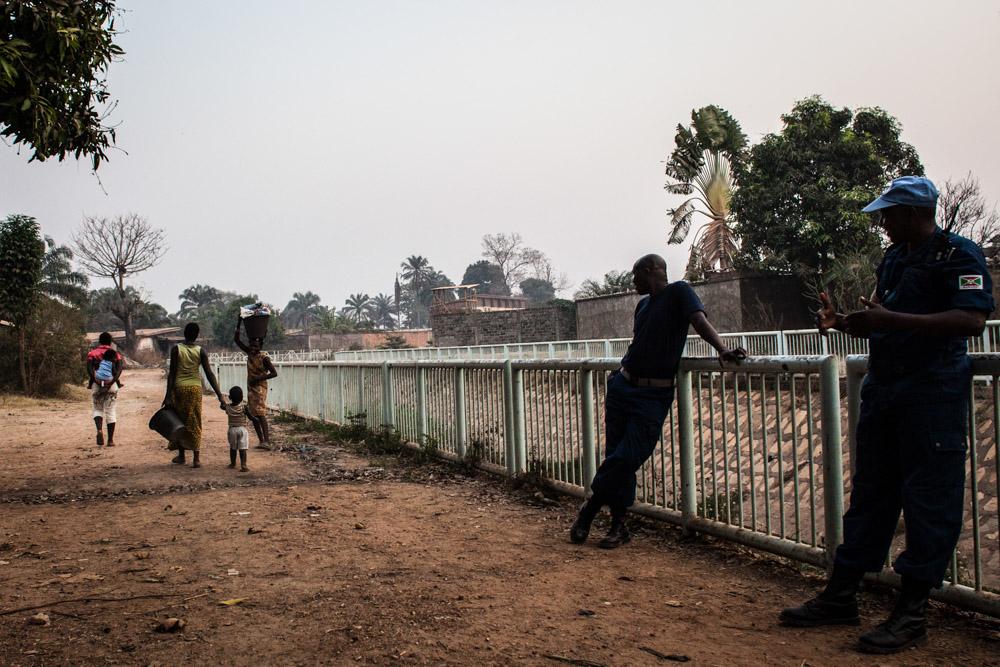 Burundian UN peacekeepers speak to a group of women and girls in Castors neighborhood in Bangui, Central African Republic.
