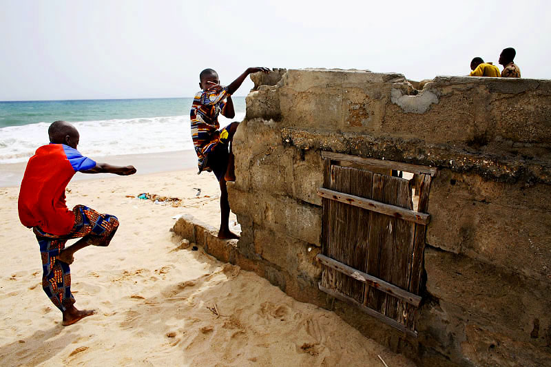 boys play by a destroyed home- totope, ghana.
